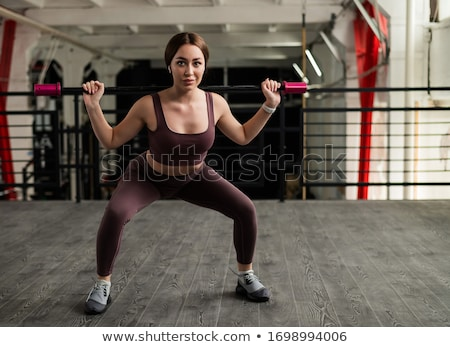 Women bending an aerobic fitness bar Stock photo © photography33