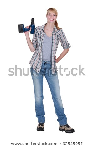 blond woman stood with power drill stock photo © photography33