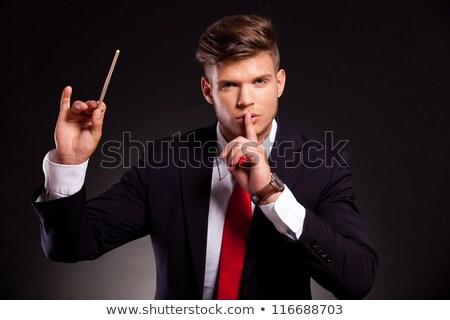 Silencio jóvenes hombre de negocios posando dedo labios Foto stock © feedough