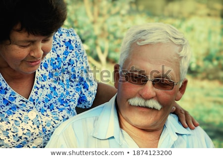 a woman embracing a man, both are laughing Stock photo © photography33
