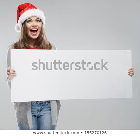 young woman in santa hat holding blank board stock photo © vankad