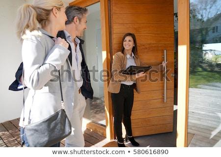 ingatlanügynök · nő · ügyfelek · pár · kék · üzlet - stock fotó © photography33
