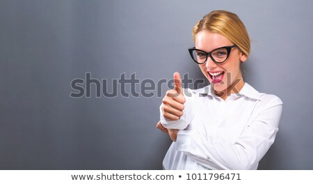Business woman giving thumb up with copyspace sign Stock photo © Maridav
