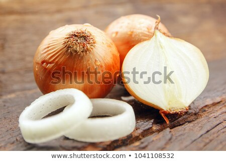 Onions and onion rings on cutting board with knife. Stock photo © Reaktori