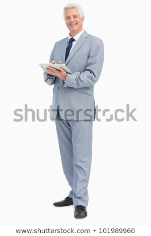 Portrait of a boss with a touch Pad against white background Stock photo © wavebreak_media