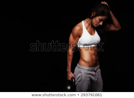 Fitness exercise crossfit woman holding kettlebell stock photo © Maridav