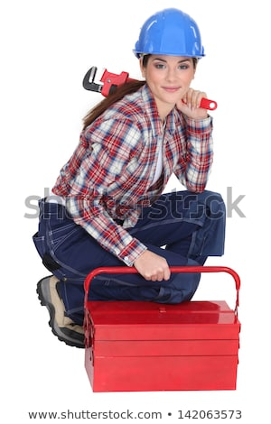 Portrait of a tradeswoman with a pipe wrench and a toolbox Stock photo © photography33