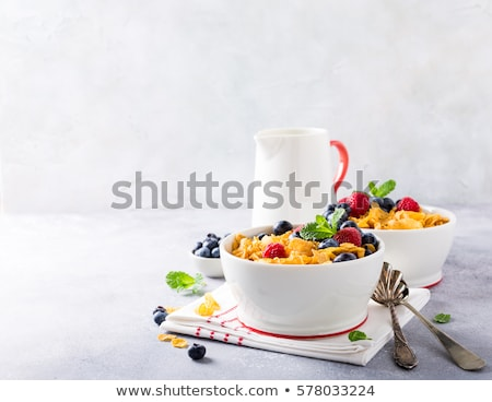 Stock photo: bowl of corn flakes with berries fruits