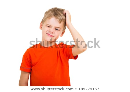 boy looking up and scratches his head isolated on white stock photo © dacasdo