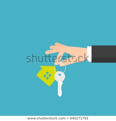 Businessman holds house keys Stock photo © Kirill_M