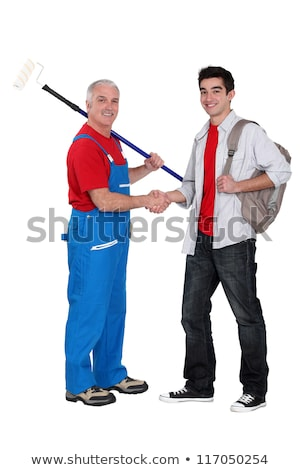 Stock photo: Decorator welcoming young starter