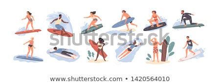 Young girl standing with surfboard on beach Stock photo © ElinaManninen