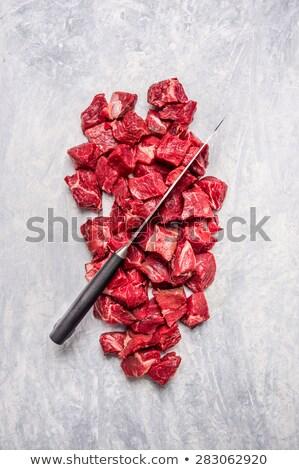 férfi · vág · hús · vágódeszka · kaukázusi · konyhapult - stock fotó © juniart