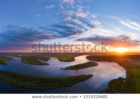 Piękna wygaśnięcia powyżej rzeki niebo streszczenie Zdjęcia stock © AEyZRiO