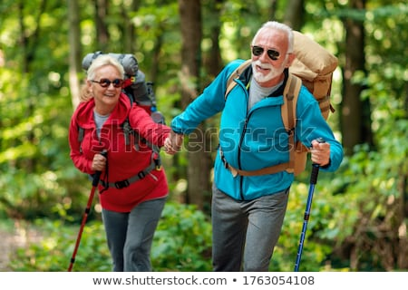 Happy couple is taking a walk in the forest Stock photo © DNF-Style