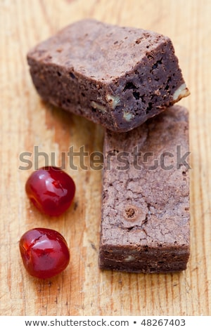 two chocolate brownies with two glacee cherries stock photo © raphotos