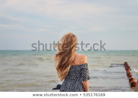 trendy young blond woman standing waiting stock photo © stryjek