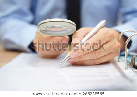 Due Diligence through Magnifying Glass. Stock photo © tashatuvango