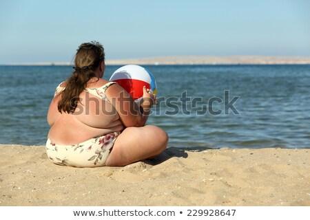 избыточный вес женщину мяча пляж сидят морем Сток-фото © Mikko
