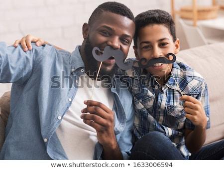 Férfi hamisítvány bajusz jóképű fiatalember tart Stock fotó © iko