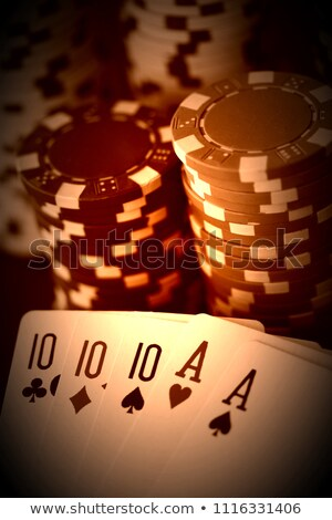 Two old poker card aces and colorful poker chips. Stock photo © latent