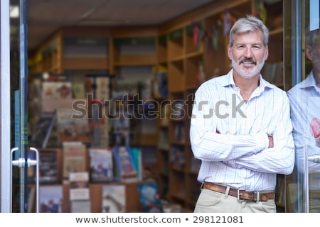 Portrait Homme librairie propriétaire à l'extérieur magasin Photo stock © HighwayStarz