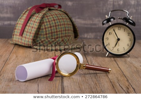 wrapped paper sheets and magnifying glass stock photo © homydesign