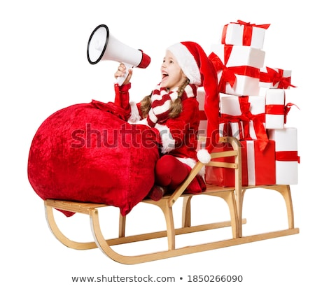 cheerful santa helper girl with big bag  Stock photo © dolgachov