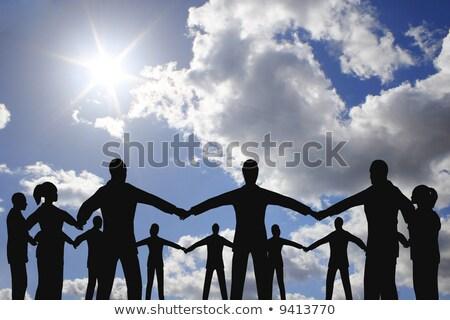 insanlar · daire · grup · bulut · güneşli · gökyüzü - stok fotoğraf © Paha_L