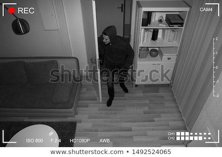 Foto d'archivio: Man With Crowbar Entering Into House