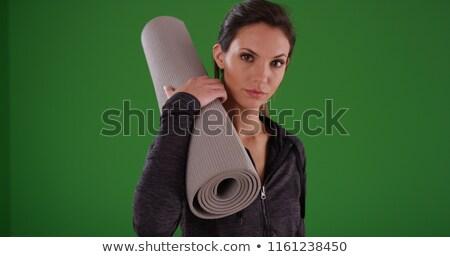 composite image of fit brunette holding yoga mat stock photo © wavebreak_media