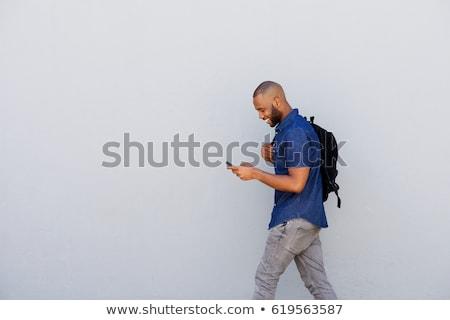 oldalnézet · lezser · férfi · kék · pólóing · sétál - stock fotó © feedough