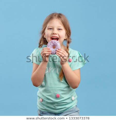 little girl holding donuts  Stock photo © mady70