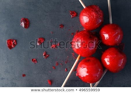 sweet glazed red toffee candy apples on sticks stock photo © stevanovicigor