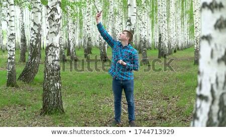 Férfi keres mobil GPS jel erdő Stock fotó © stevanovicigor