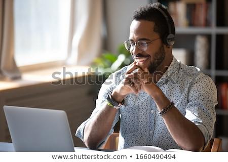 boldog · fiatalember · beszél · headset · közelkép · portré - stock fotó © nyul