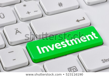 a keyboard with a green button   investment stock photo © zerbor