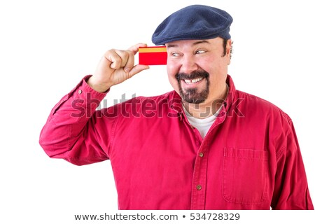 Gleeful man eyeing his credit card with a smile Stock photo © ozgur