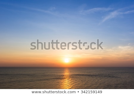 abstract landscape with sea waves and rising sun Stock photo © LoopAll