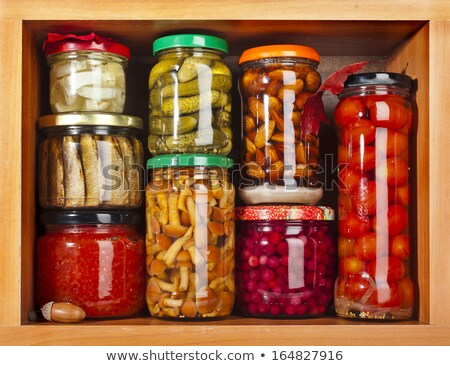 Many canned food on wooden shelves Stock photo © bluering