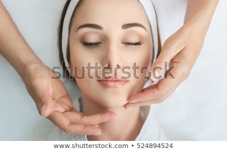 face massage close up of a beautiful woman getting spa treatmen stock photo © yatsenko