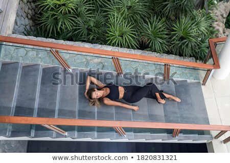 female posing lying on the stairs stock photo © dash