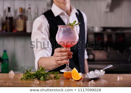 sangria coctail bartender is making cocktail at bar counter at stock photo © yatsenko