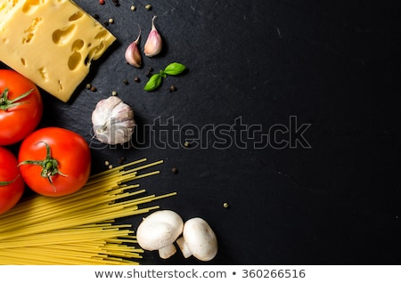image of a mushrooms over dark background stock photo © deandrobot
