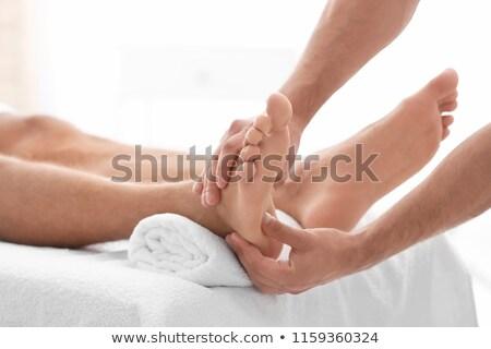 Homme pieds jaune canapé noir corps Photo stock © simply
