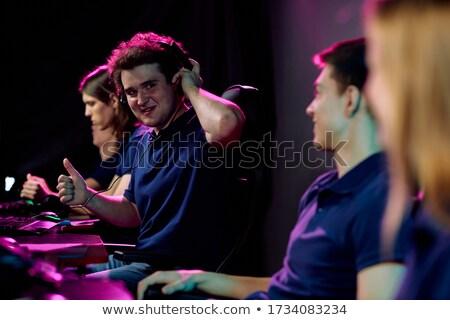 Entusiasta feminino jogar música popular concerto Foto stock © wavebreak_media