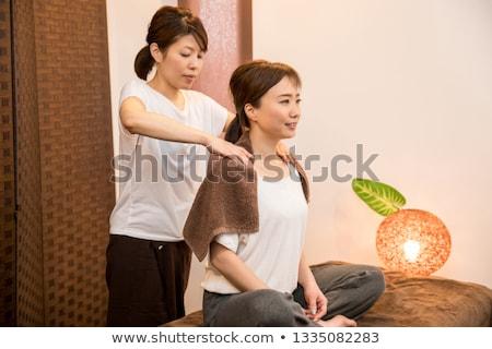 Happy woman receiving neck massage  stock photo © wavebreak_media