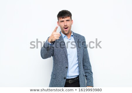 furious young business man looking like a mad man Stock photo © feedough