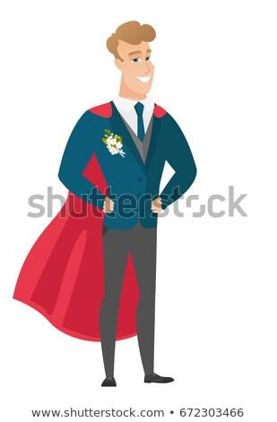 Groom wearing a red superhero cloak. Stock photo © RAStudio