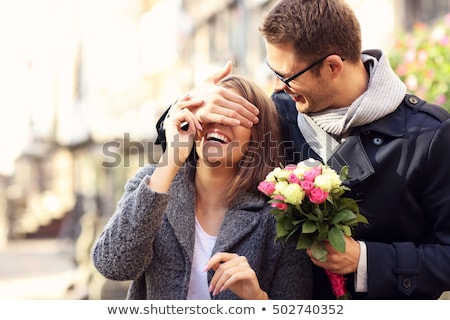 man giving flowers to a woman stock photo © is2